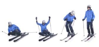 Skiier demonstrieren, wie man oben im Skifahren steht Stockfoto