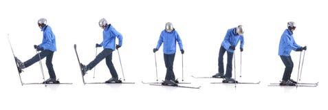 Skiier dimostra come trasformarsi nella direzione opposta Fotografia Stock