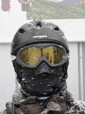 Skiier with face completely covered wearing a helmet and goggles Royalty Free Stock Photography