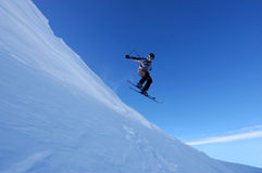 Skiing. Skier flying off a cornice Royalty Free Stock Photo