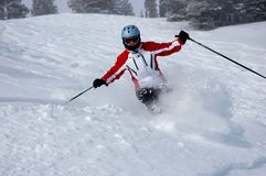 Skiing. Woman skiing in fresh Utah powder Royalty Free Stock Photos