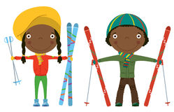 Skiing. Funny cool African-American kids with skis isolated on white background Royalty Free Stock Images