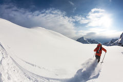 Skiing. Freerider skier moving down in snow powder; italian alps Stock Photography