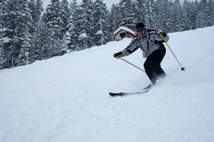 Skiing. Man skiing fast on a cloudy day Stock Photo