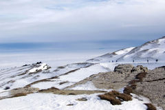 Skiing above the clouds. Nice landscape of skiers above the clouds Stock Photography