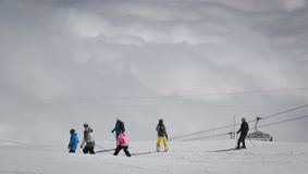Skiing above the clouds stock photography
