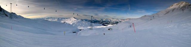 Skiing all the way down panorama Royalty Free Stock Photos
