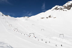 Skiing in alps Royalty Free Stock Images