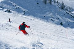 Skiing in Alps stock photos