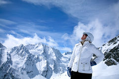 Skiing in Alps, Austria. Woman is enjoying the view of high mountains in Solden, Austria Stock Photo