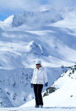 Skiing in Alps, Austria. Woman is taking a break after skiing, Solden, Austria Royalty Free Stock Photo