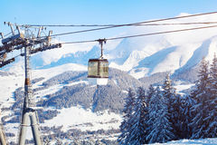 Skiing in Alps, ski lift cabine in mountains Royalty Free Stock Images