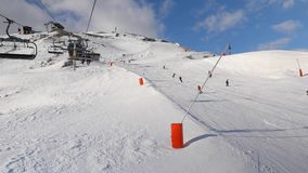 Skiing in the Alps. Using ski lift in the Alps, people skiing on the slopes stock video footage