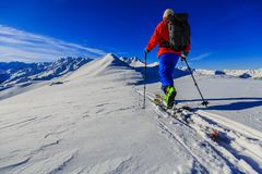 Skiing with amazing view of swiss famous mountains in beautiful Royalty Free Stock Photo