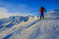 Skiing with amazing view of swiss famous mountains in beautiful Royalty Free Stock Photos