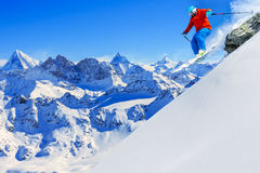 Skiing with amazing view of swiss famous moutains in beautiful w Royalty Free Stock Image
