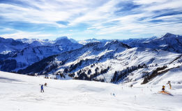 Skiing in the austrian alps. On a sunny day Royalty Free Stock Image