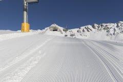 Skiing background - fresh snow on ski slope Stock Photos