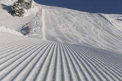 Skiing background - fresh snow on ski slope Royalty Free Stock Image