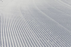 Skiing background - fresh snow on ski slope Stock Photos