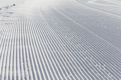 Skiing background - fresh snow on ski slope Royalty Free Stock Photo