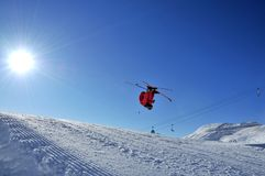 Skiing backwards into the sun stock photography
