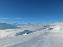Skiing in Bettmeralp. The pistes of the Aletsch Arena area are beautiful and serenely quiet. The beautiful cloud cover is obstructing our view into the valley Stock Photo