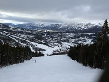 Skiing in Big Sky, Montana. A ski trail in Big Sky, Montana. Nice mountains in the background Stock Photo