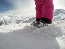 Skiing boots on snow-body part Royalty Free Stock Photography