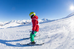 Skiing boy hitting down a hill in alpine resort Royalty Free Stock Images