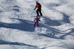 Skiing on a bumpy slope stock photos