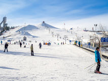 Skiing at Canada Olympic Park. CALGARY, CANADA - MAR 1: People enjoying the skiing at Canada Olympic Park on March 1, 2015 in Calgary, Alberta. Visible are Stock Images