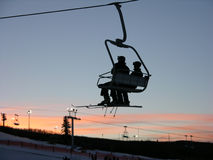 Skiing chair. Sunset on skiing chair royalty free stock images