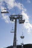 Skiing chair lift Royalty Free Stock Image