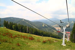 Skiing chair lift. Chair lift in Carpathian Mountains Royalty Free Stock Images