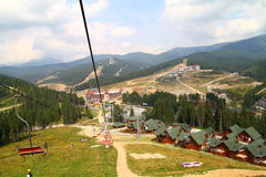 Skiing chair lift. Chair lift in Carpathian Mountains Bukovel Stock Photo