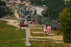 Skiing chair lift. Chair lift in Carpathian Mountains with people Stock Photography