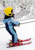 Skiing child on rope lift Royalty Free Stock Images
