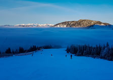 Skiing into clouds. In winter time Royalty Free Stock Image