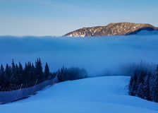 Skiing into clouds. In winter time Stock Photo