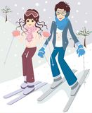 Skiing couple. Couple outdoor in a winter setting. The active couple is about to go crosscountry skiing Royalty Free Stock Image
