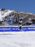 Skiing cowbys hit the jump Royalty Free Stock Image