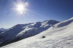 Skiing in the Davos. Nice view on the ski slope in the Swiss alps - Davos Royalty Free Stock Photography