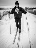 Skiing with Dog. An older man cross country skiing with his dog Stock Images