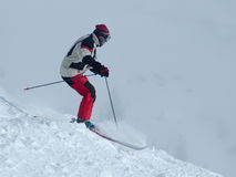 Skiing down the hill Royalty Free Stock Photos