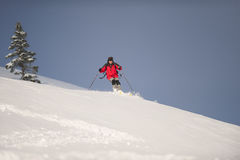 Skiing down mountains Stock Images