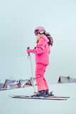 Skiing down the slope. Girl skiing down the slope Stock Image