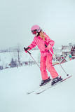 Skiing down the slope. Girl skiing down the slope Royalty Free Stock Photography