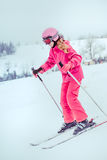 Skiing down the slope. Girl skiing down the slope Royalty Free Stock Image