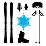 Skiing equipment silhouette with snowflake Royalty Free Stock Image
